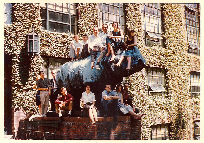 Riddle and Watson share a perch atop rhinoceros with research group at Harvard, 1962